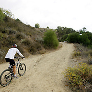 LOS ANGELES, CA, October 2, 2007: Mountain bikers enjoy the Santa Monica Mountains by way of Malibu Creek State Park on a fall day in September, 2007. (Photo by Todd Bigelow/Aurora)