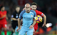 Adam Lallana of Liverpool  and Pablo Zabaleta of Manchester City during the English Premier League match at Anfield Stadium, Liverpool. Picture date: December 31st, 2016. Photo credit should read: Lynne Cameron/Sportimage