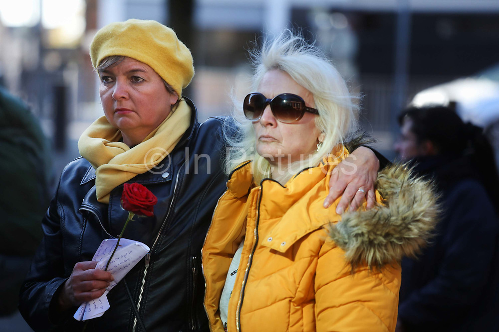 """Outside Preston Crown Court family, friends and supporters have gathered to a quiete and respectful show of solidarity using roses to symbolise the Lancashire Rose September 25th, Preston, Lancashire, United Kingdom.<br /> <br /> <br /> Simon Roscoe Blevins, 26,  Richard Roberts, 36 were both sentenced 16 months in prison, Richard Loizou, 31, sentenced 15 months in prison and  and Julian Brock, 47 12 months supended. <br /> <br /> <br /> Simon Roscoe Blevins, 26,  Richard Loizou, 31, Richard Roberts, 36 and Julian Brock, 47 climbed on top of several trucks during a mass protest by locals and supporters in New Preston Road, against fracking in Lancashire, July 2017. The trucks were prevented form delivering equipment to Cuadrillas nearby fracking site for four days.  <br /> <br /> After a seven day jury trial at Preston Crown Court in August 2018, the four men were found guilty of Public Nuisance. Judge Altham has told them to expect """"immediate custodial sentences"""" on 25th September 2018."""
