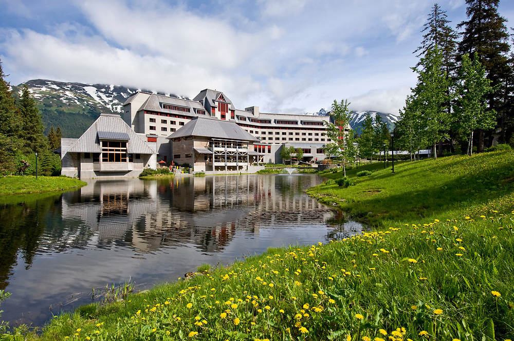 Verdant greenery surrounding a pond with lovely landscaping at the The Hotel Alyeska in spring.  Girdwood Alaska.