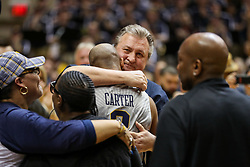 Feb 26, 2018; Morgantown, WV, USA; West Virginia Mountaineers head coach Bob Huggins hugs West Virginia Mountaineers guard Jevon Carter (2) during senior night ceremonies before their game against the Texas Tech Red Raiders at WVU Coliseum. Mandatory Credit: Ben Queen-USA TODAY Sports