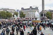 People take part in a 'We Do Not Consent' rally at Trafalgar Square, organised by Stop New Normal, to protest against coronavirus restrictions, in London on Saturday, Sept. 26, 2020. (VXP Photo/ Vudi Xhymshiti)