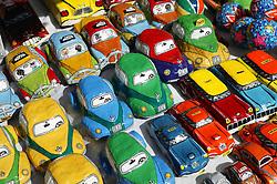 Painted papier mache model cars on stall in tourist market; Havana; Cuba,