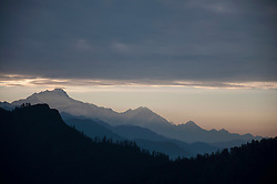 Mountain landscape peaks sunset forest silhouette