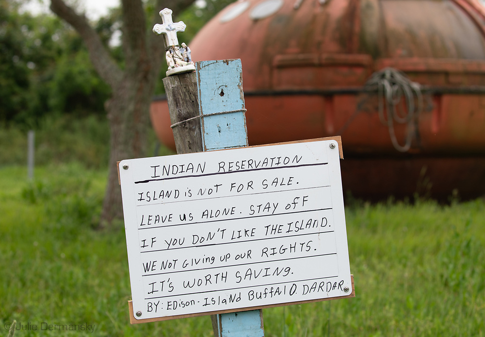 Sign on Isle de Jean Charles posted by island resident Edison Dardar, across from his home on April 13, 2019.
