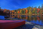 Autumn foliage and canoes at Promised Land State Park lake, Pike County, PA