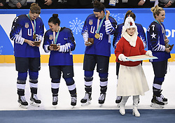 February 22, 2018 - Pyeongchang, South Korea - Left to right, LEE STECKLEIN, CAYLA BARNES and MEGAN KELLER of the United States examine their gold medals after beating Canada in the Women's Gold Medal Ice Hockey game Thursday, February 22, 2018 at Gangneung Hockey Centre at the Pyeongchang Winter Olympic Games. USA took the gold. Photo by Mark Reis, ZUMA Press/The Gazette (Credit Image: © Mark Reis via ZUMA Wire)