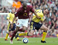 Photo: Ed Godden.<br />Arsenal v Aston Villa. The Barclays Premiership. 01/04/2006. Abou Diaby (L) and Villa's Gavin McCann, clash.