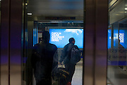Heathrow Express lift passengers exiting lift at Heathrow airport's terminal 5.
