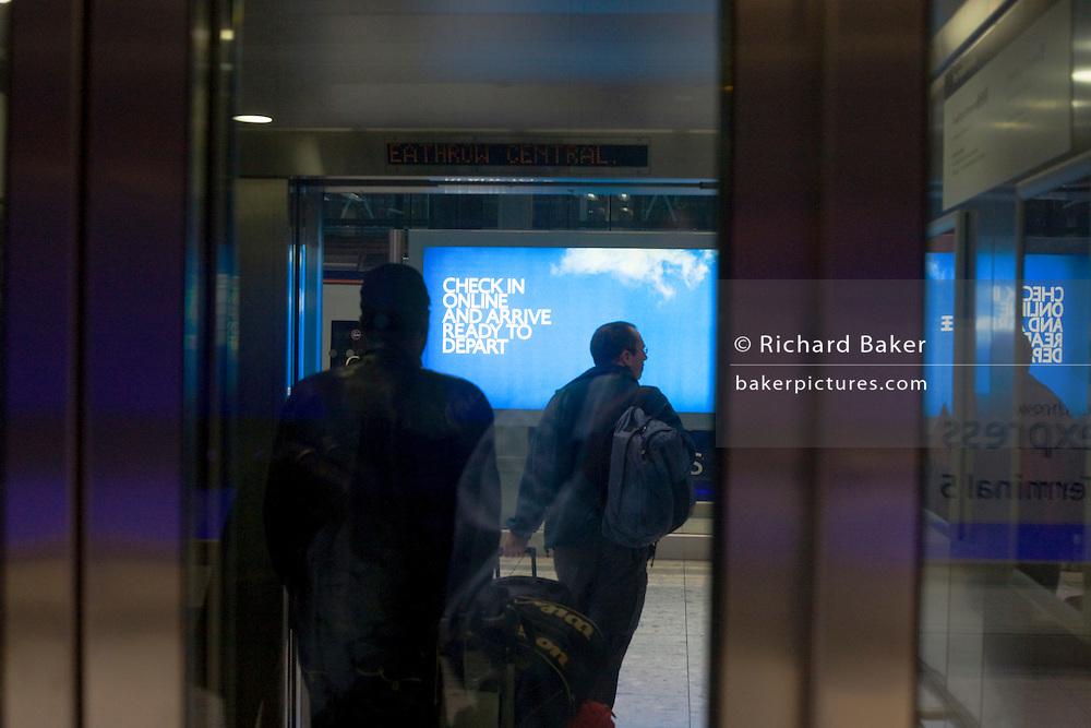 Heathrow Express lift passengers exiting lift at Heathrow airport's terminal 5.