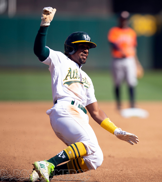 Sep 26, 2021; Oakland, California, USA; Oakland Athletics second baseman Tony Kemp (5) slides safely into third base as he went from first to third on a single by Yan Gomes against the Houston Astros in the fourth inning at RingCentral Coliseum. Mandatory Credit: D. Ross Cameron-USA TODAY Sports