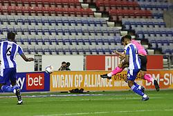Jonson Clarke-Harris of Peterborough United scores the opening goal against Wigan Athletic - Mandatory by-line: Joe Dent/JMP - 20/10/2020 - FOOTBALL - DW Stadium - Wigan, England - Wigan Athletic v Peterborough United - Sky Bet League One