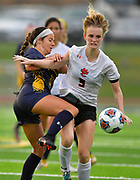 OFallon midfielder Ella Peterson (left) and Edwardsville forward Payton Federmann wrestle for the ball. OFallon defeated Edwardsville in a girls soccer playoff game at OFallon High School in OFallon, IL on Tuesday June 8, 2021. <br /> Tim Vizer/Special to STLhighschoolsports.com.