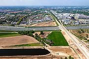 Nederland, Noord-Brabant, Den Bosch, 09-05-2013; werkzaamheden aan de Zuid-Willemsvaart. Kruising met spoorlijn, gezien in de richting van Den Bosch.Het kanaal wordt verbreed, uitgegraven en omgelegd - zodat de binnenstad van Den Bosch vermeden kan worden. Het gaat niet alleen om een omlegging, maar ook om een opwaardering zodat grote schepen van het kanaal gebruik kunnen blijven maken.<br /> View on works on the Zuid-Willemsvaart (channel) next to motorway A2 and crossing the railway,  near Den Bosch (Southern Netherlands).<br /> luchtfoto (toeslag op standaard tarieven);<br /> aerial photo (additional fee required);<br /> copyright foto/photo Siebe Swart.