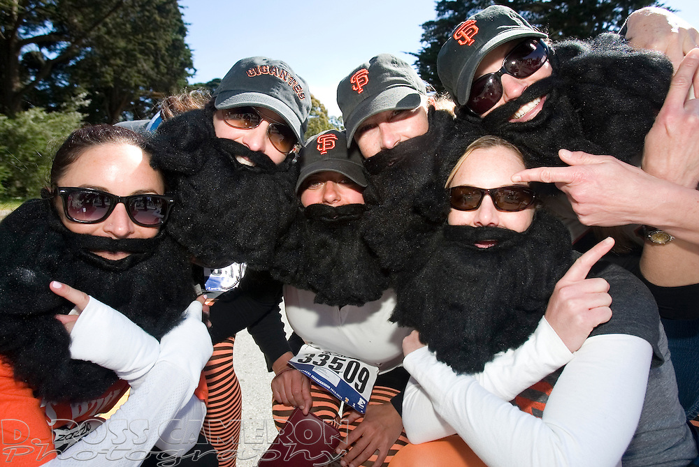 """A group of San Francisco Giants fans encourage us to """"Fear the Beard,"""" as they pose for a photograph during the 100th running of the Bay to Breakers 12K through San Francisco, Sunday, May 15, 2011. (Photo by D. Ross Cameron)"""