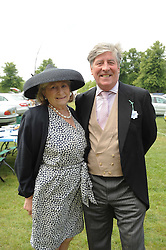 MR & MRS CHARLES CARTER at the first day of the 2010 Royal Ascot Racing festival at Ascot Racecourse, Berkshire on 15th June 2010.