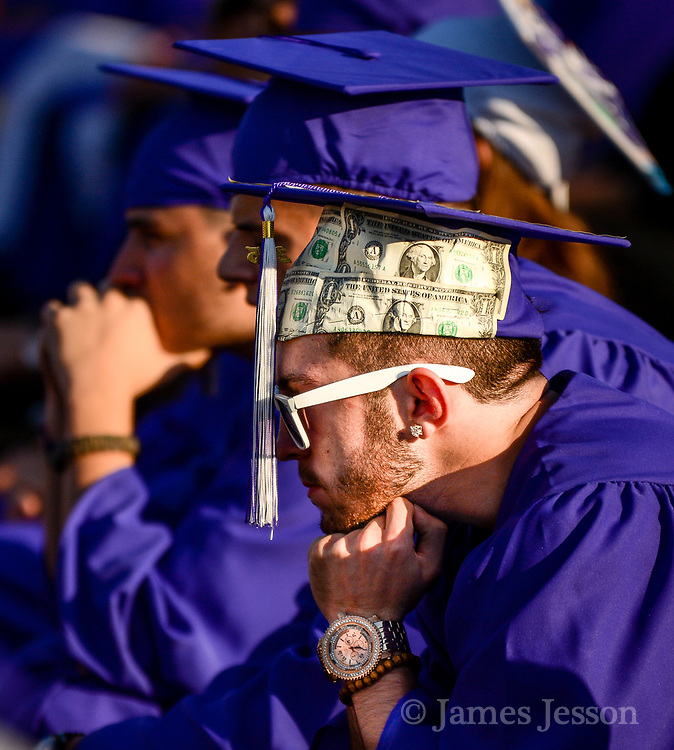 A soon-to-be graduate waiting with money on his mind.