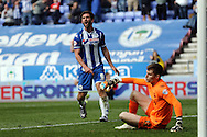Will Grigg of Wigan Athletic reacts to being flagged offside. Skybet football league one match , Wigan Athletic v Southend Utd at the DW Stadium in Wigan, Lancs on Saturday 23rd April 2016.<br /> pic by Chris Stading, Andrew Orchard sports photography.
