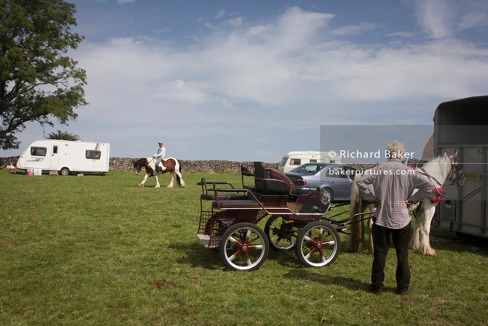 A young traveller tries out a new pony at the ancient annual Priddy Sheep (and horse) fair in Somerset, England. The young man rides bareback around a field on the outskirts of the village. Set in the Mendip Hills, in the south-western English county of Somerset, the Priddy Sheep fair is host to an odd mix of farmers and travellers (commonly and incorrectly known as gypsies). In this field set aside purely for travellers, many with West Country accents but also with nearby Welsh and Irish too, deals are done with a traditional spit on the hand and a smacking of palms, selling a pony to another family. The Priddy Sheep Fair moved from the city of Wells in 1348 because of the Black Death.