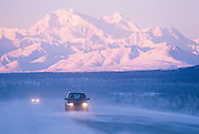 Alaska. Summit. Blowing snow on the George Parks Highway, Alaska Range in distance.