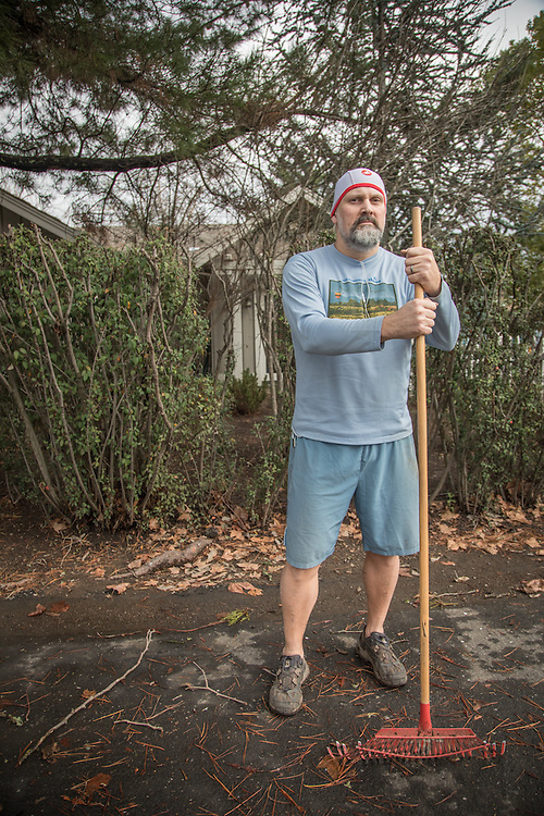 """""""I think its important to get out and elevate the heart rate.""""  -Winery sales and hospitality employee John DeGregory cleans up post-storm debris in front of his home on Oak Street in Calistoga."""