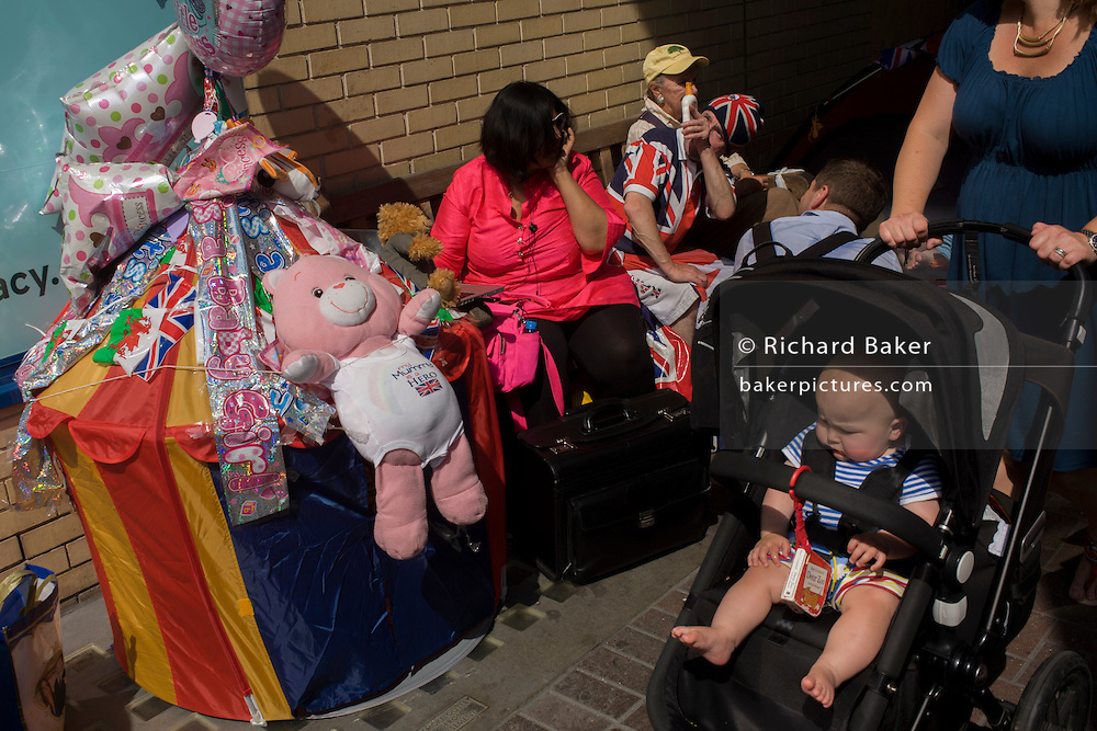 Royalists and Disney balloons as tension mounts outside St Mary's Hospital, Paddington London, where media and royalists await news of Kate, Duchess of Cambridge's impending labour and birth to a baby boy. Some have been camping out for up to two weeks during a UK heatwave, having bagged the best locations where the heir to the British throne will eventually be shown to the waiting world.
