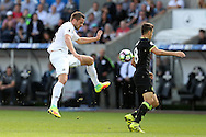 Gylfi Sigurdsson of Swansea city has a shot at goal blocked by Oscar of Chelsea. Premier league match, Swansea city v Chelsea at the Liberty Stadium in Swansea, South Wales on Sunday 11th Sept 2016.<br /> pic by  Andrew Orchard, Andrew Orchard sports photography.