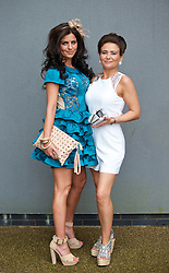 LIVERPOOL, ENGLAND - Friday, April 4, 2014: Antonia Dallas and Rachel Green of Speke, Liverpool, during Ladies' Day on Day Two of the Aintree Grand National Festival at Aintree Racecourse. (Pic by David Rawcliffe/Propaganda)