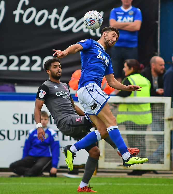 Lincoln City's Bruno Andrade vies for possession with Macclesfield Town's James Pearson<br /> <br /> Photographer Andrew Vaughan/CameraSport<br /> <br /> The EFL Sky Bet League One - Macclesfield Town v Lincoln City - Saturday 15th September 2018 - Moss Rose - Macclesfield<br /> <br /> World Copyright © 2018 CameraSport. All rights reserved. 43 Linden Ave. Countesthorpe. Leicester. England. LE8 5PG - Tel: +44 (0) 116 277 4147 - admin@camerasport.com - www.camerasport.com