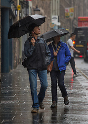 © Licensed to London News Pictures.  09/09/2021. Edinburgh, Scotland. People take shelter from the rain underneath umbrellas in Edinburgh. Scotland is currently the Covid capital of the UK with 17 out of 20 hotspots north of the border. Photo credit: Marcin Nowak/LNP