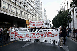 November 1, 2018 - Athens, Greece - Protesters are seen holding a banner during the strike..Interdisciplinary union workers strike against redundancies of workers and about the wage increases. (Credit Image: © Giorgos Zachos/SOPA Images via ZUMA Wire)
