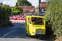 Cookham Dean, UK. 1 September, 2019. A custom-built kart in the form of Trotter's Independent Trading Reliant Regal van from the TV series 'Only Fools and Horses' competes in the Cookham Dean Gravity Grand Prix in aid of the Thames Valley and Chiltern Air Ambulance.