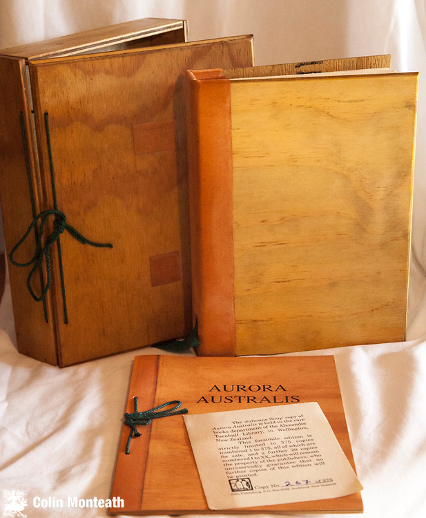 """AURORA AUSTRALIS, #267 of 500 Seto Publishing, Auckland, 1988.,  Replica copy of 1st book written printed, published and bound in Antarctica at Cape Royds during Shackleton's 1907-09 Nimrod British Antarctic Expedition, This is by far the best of the facsimile editions of Aurora Australis as it is an exact reproduction of the """"Julienne Soup"""" copy from Alexander Turnbull Library, Wellington, complete with plywood covers, ribbons, comes in plywood replica box. with booklet describing the expedition and how the book was created by expedition members... The 'Julienne Soup' copy of Aurora Australis held in the rare books department of the Alexander Turnbull Library in Wellington, New Zealand, originally bequested by Sir Joseph Kinsey, founder of the shipping and insurance brokerage company, Kinsey, Barnes & Co. Accompanying booklet contains an introduction by Mary P. Goodwin, which describes the history of the publication of the original work, an article from the Daily Telegraph of June 12, 1909 that appeared when the expedition returned home, and a page containing the signatures of the explorers....a series of poems, colour paintings, stories on daily life on Ross Island. VG+ scarce $NZ950."""