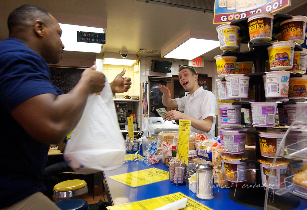 Dave, one of Bob and Edith's 28 employees, exchanges pleasentries with Travis, a local customer picking up a carryout order. Although the surroundings have changed, Bob & Edith's Diner has remained the same for nearly 42 years. A staple in Arlington, VA, three generations of Bolton's have been serving food 24 hours a day to hungry customers from around the Washington D.C. Metropolitan Area.