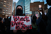 OAKLAND, CA - MAY 29: A demonstrator displays a sign during protests against the death of George Floyd in police custody, in Oakland, California on May 29, 2020. (AP Photo/Philip Pacheco)