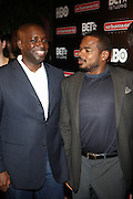 l to r: Stacy Spikes and F.Gary Gray at The 13th Annual UrbanWorld Film Festival Premiere of ' Law Abiding Citizen'  held at AMC 34th Street on September 23, 2009 in New York City