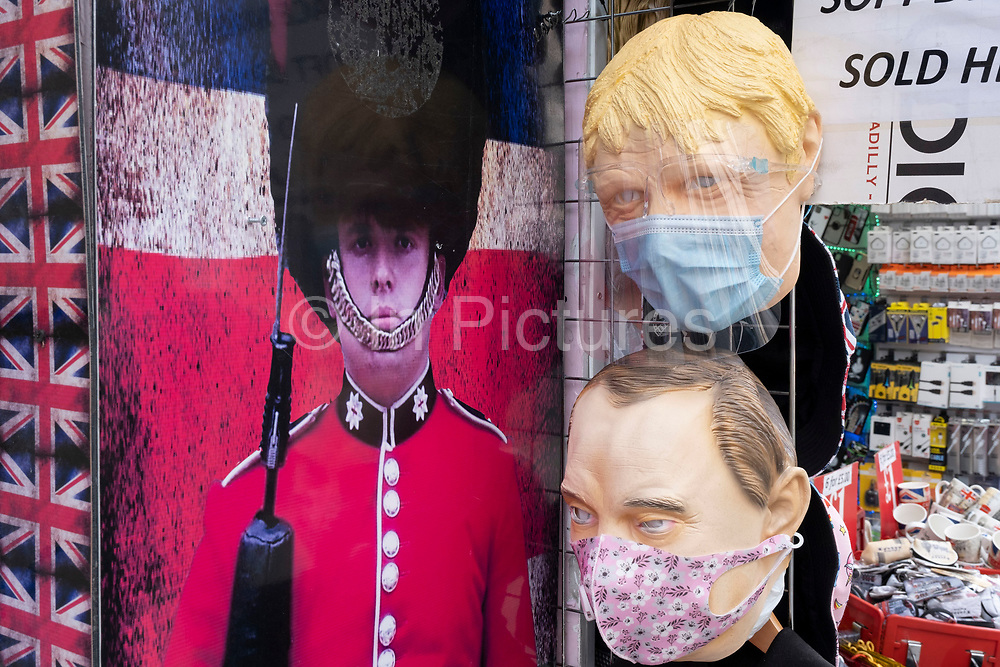 As Britain enters a period of deep recession, with some shops closing either temporarily or permanently as the economic downturn caused by the Covid-19 pandemic cuts hard, shoppers wearing face masks come to the West End to Oxford Street where face coverings, including some of political figures like Boris Johnson, are also on sale on 13th August 2020 in London, United Kingdom. The Office for National Statistics / ONS has announced that gross domestic product / GDP, the widest gauge of economic health, fell by 20.4% in the second quarter of the year, compared with the previous quarter. This is the biggest decline since records began. The result is that Britain has officially entered recession, as the UK economy shrank more than any other major economy during the coronavirus outbreak.