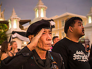 05 NOVEMBER 2016 - BANGKOK, THAILAND:  A member of a Thai paramilitary unit salutes during the National Anthem at the end of the day near the Grand Palace in Bangkok. Crowd of mourners continue to go to the palace to honor the King, Bhumibol Adulyadej, nearly three weeks after his death.    PHOTO BY JACK KURTZ