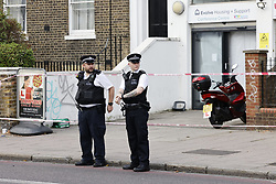 © Licensed to London News Pictures. 16/09/2020. London, UK. A cordon remains in place in Stockwell Road, south London after a man in his twenties was found with stab injuries. Police were called at approximately 14:51hrs on Tuesday, September 15 after the victim was discovered. Despite the best efforts of paramedics, he was pronounced dead at the scene. Police inquiries continue. Photo credit: Peter Macdiarmid/LNP