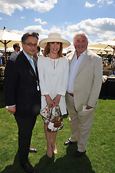 Left to right, TOMASZ STARZEWSKI,  STEFANIE POWERS and CHRISTOPHER BIGGINS at the 27th annual Cartier International Polo Day featuring the 100th Coronation Cup between England and Brazil held at Guards Polo Club, Windsor Great Park, Berkshire on 24th July 2011.