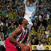 Olympiacos's Kyle Hines (L) during their Euroleague Basketball Game 7 match Fenerbahce Ulker between Olympiacos at Sinan Erdem Arena in Istanbul, Turkey, Thursday, December 01, 2011. Photo by TURKPIX