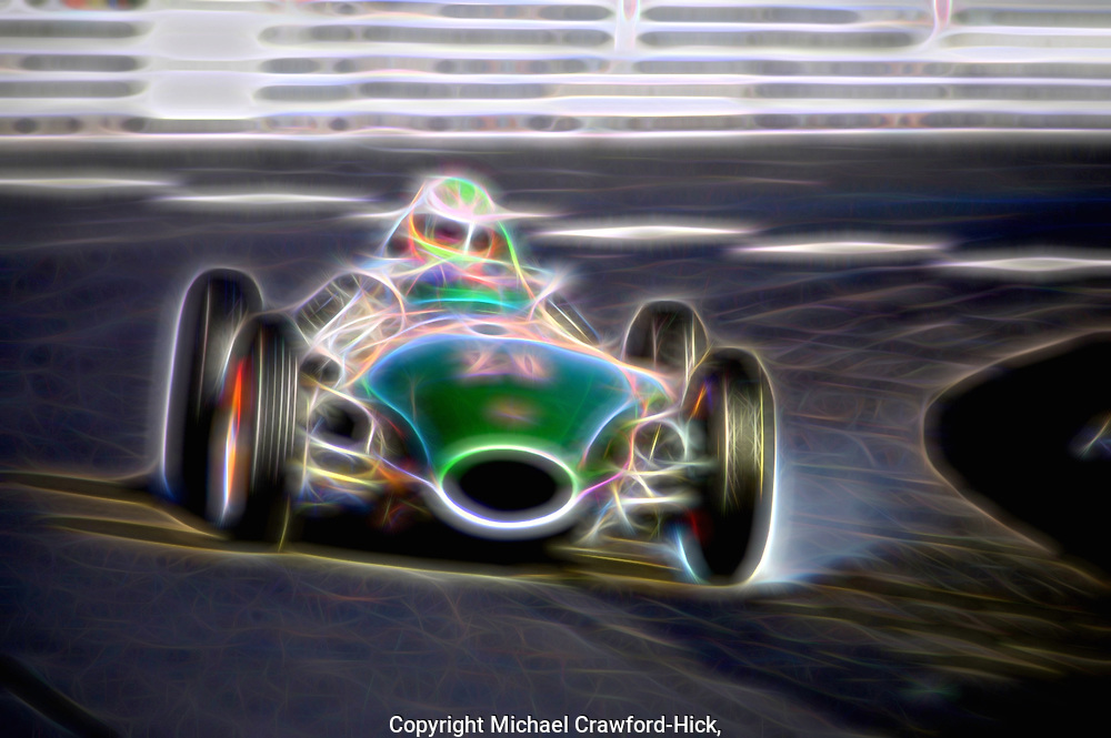 Historic Grand Prix Monaco, no 20 racing green race car making a turn with a locked up wheel