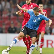 Turkey's Hakan BALTA (L) and Estonia's Martin VUNK (R) during their a international friendly soccer match Turkey betwen Estonia at TT Arena Istanbul August 10, 2011. Photo by TURKPIX