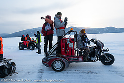 Sean Lichter riding on the back of the fuel trike in the Baikal Mile Ice Speed Festival competitors parade on the lake. Maksimiha, Siberia, Russia. Saturday, February 29, 2020. Photography ©2020 Michael Lichter.