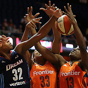UNCASVILLE, CONNECTICUT- JUNE 3:  Bria Holmes #32 of the Atlanta Dream challenges for a rebound with Morgan Tuck #33 of the Connecticut Sun and Chiney Ogwumike #13 of the Connecticut Sun during the Atlanta Dream Vs Connecticut Sun, WNBA regular season game at Mohegan Sun Arena on June 3, 2016 in Uncasville, Connecticut. (Photo by Tim Clayton/Corbis via Getty Images)