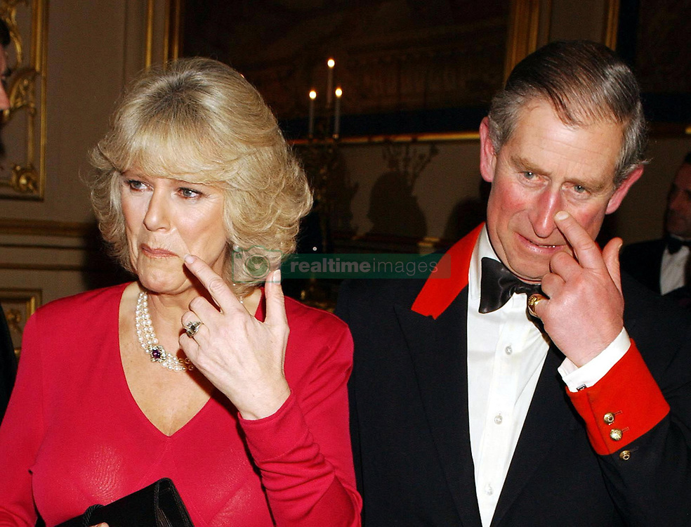 File photo dated 10/02/05 of the Prince of Wales and fiance Camilla Parker Bowles in the grand reception room of Windsor Castle, Berkshire, after announcing they are to be married on 8 April. The Duchess of Cornwall will celebrate her 70th birthday on Monday.