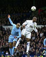 Photo. Glyn Thomas.<br /> Leeds United v Tottenham Hotspur. Premiership. <br /> Elland Road, Leeds. 10/01/2004.<br /> Frederic Kanoute (L) fires in a header on goal past Leeds' Michael Duberry.