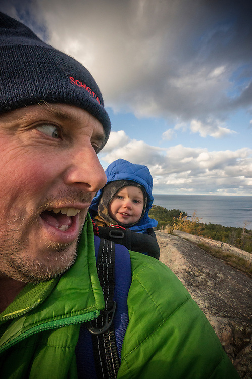 A father and son selfie while hiking along the rocky spines of the Huron Mountains near Marquette, Michigan.