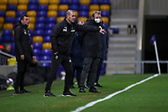 AFC Wimbledon manager Mark Robinson stood on touchline pointing during the EFL Sky Bet League 1 match between AFC Wimbledon and Gillingham at Plough Lane, London, United Kingdom on 23 February 2021.