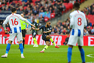 Manchester City midfielder Raheem Sterling (7) takes a shot on goal from outside the box during the The FA Cup semi-final match between Manchester City and Brighton and Hove Albion at Wembley Stadium, London, England on 6 April 2019.